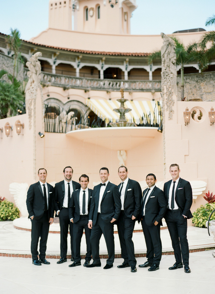 Groomsmen in classic black suits at Palm Beach wedding. Photo by Kat Braman