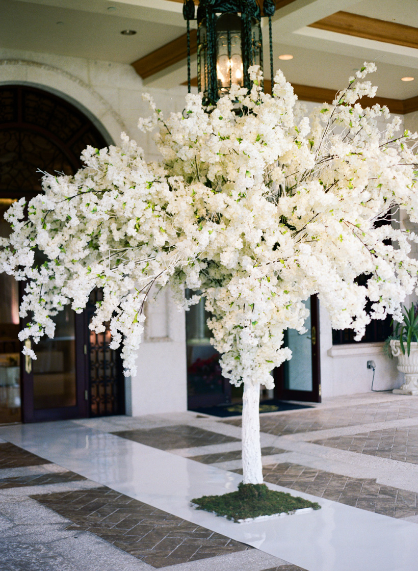 Beautiful floral installation to welcome guests to the wedding ceremony at Mar-a-Lago Club. Florals: Flowers by Brian. Photo by Kat Braman