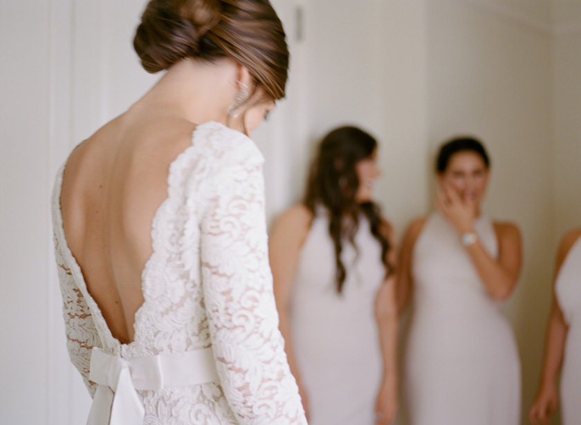 Bridesmaids seeing Bride in dress for the first time