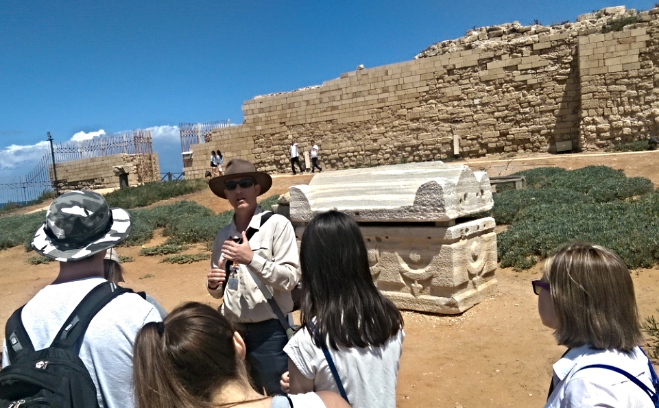 Yair leads the charge at the ruins of Caesarea, trumpet in tow.