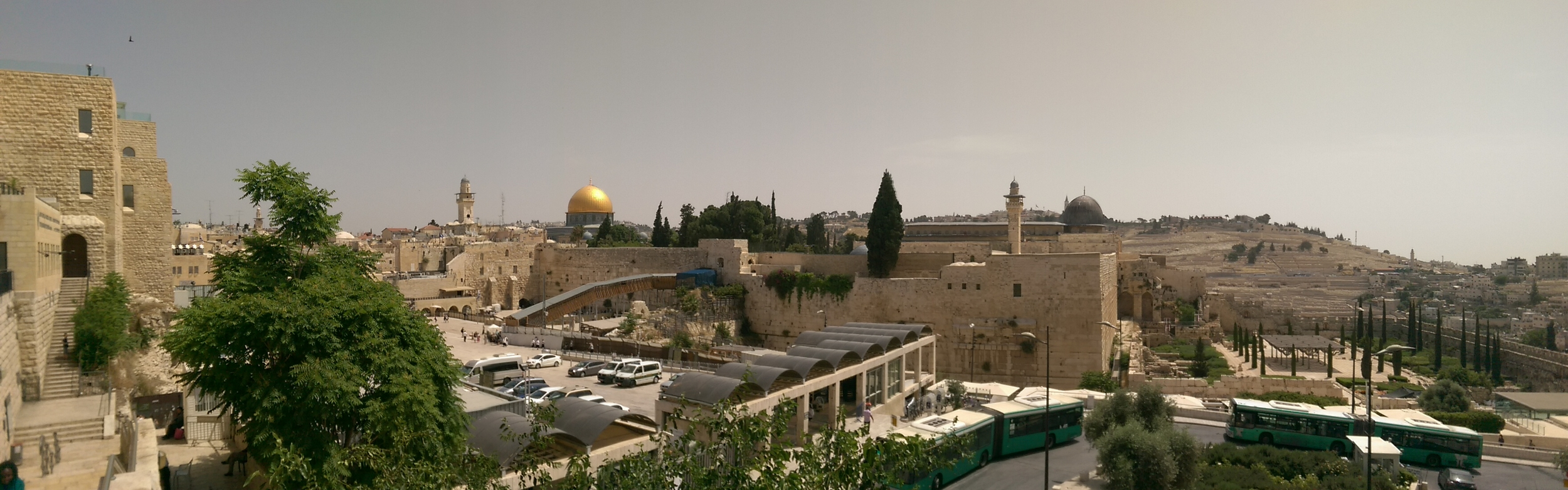 Glimpse of the Temple Mount, with the Dome of the Rock (gold) and the Western Wall in front of that.