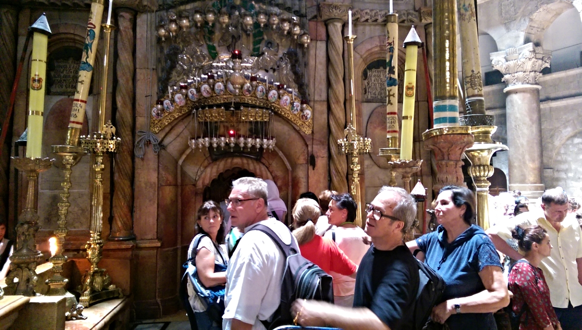 People waiting in line to see Jesus' tomb inside the Church of the Holy Sepulchre.