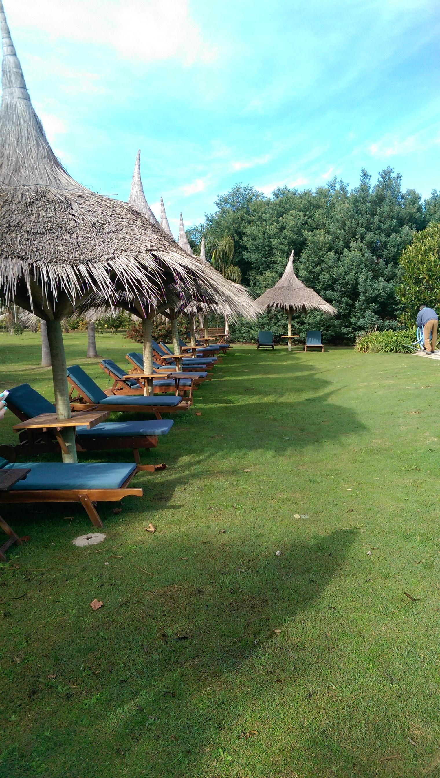 Poolside seating at  La Casa de los Limoneros .