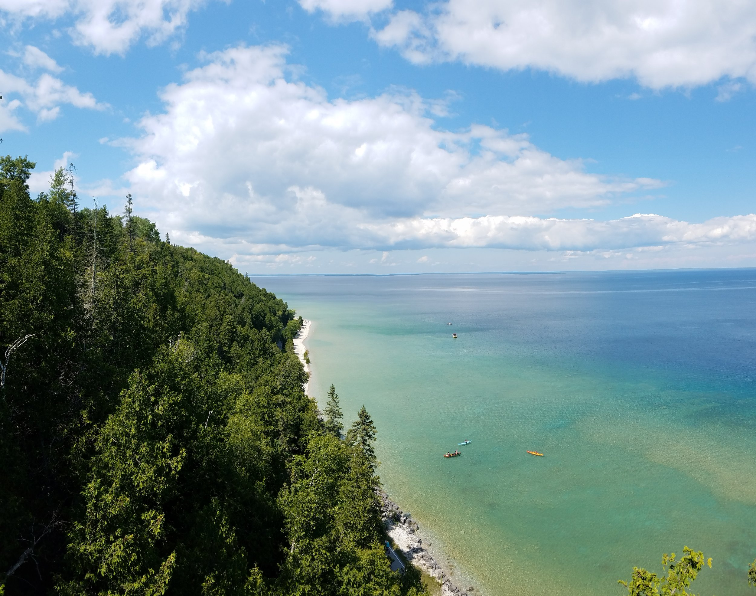 Looking northeast-ish from Mackinac Island's Arch Rock one can see that varying shades of blue and green, with other optional colors intermittently sprinkled in, can make for an eyeball-pleasing experience. Perhaps you'd like to take it all in with a  kayak tour from Great Turtle ?