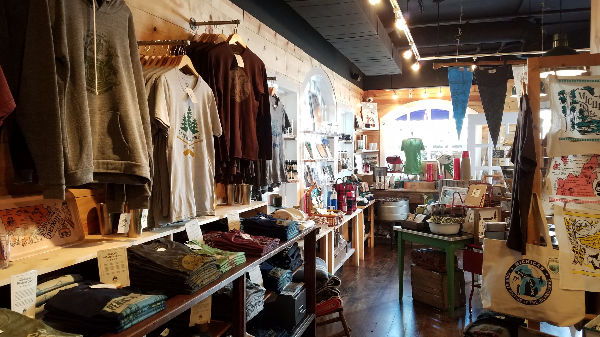 Canvas & Paddle , a Main Street store that opened in May 2017,specializes in selling apparel, household items and décor, and assorted bric-a-brac. MyNorth.com had  this  to say about it and the new Doud's Market & Deli in an article published in April.