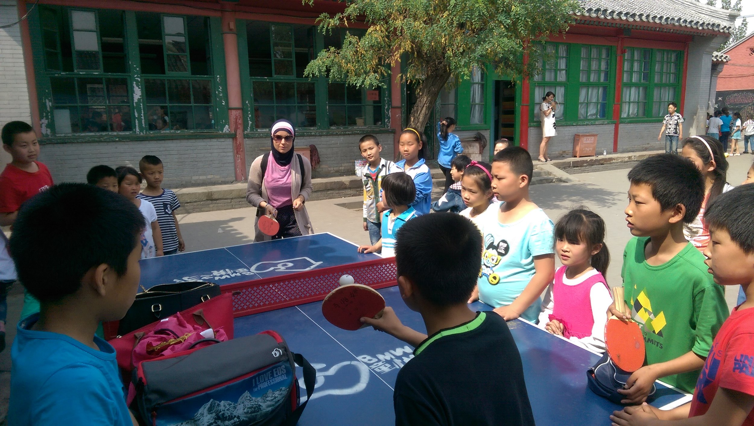 Nadine holds serve at the migrant school
