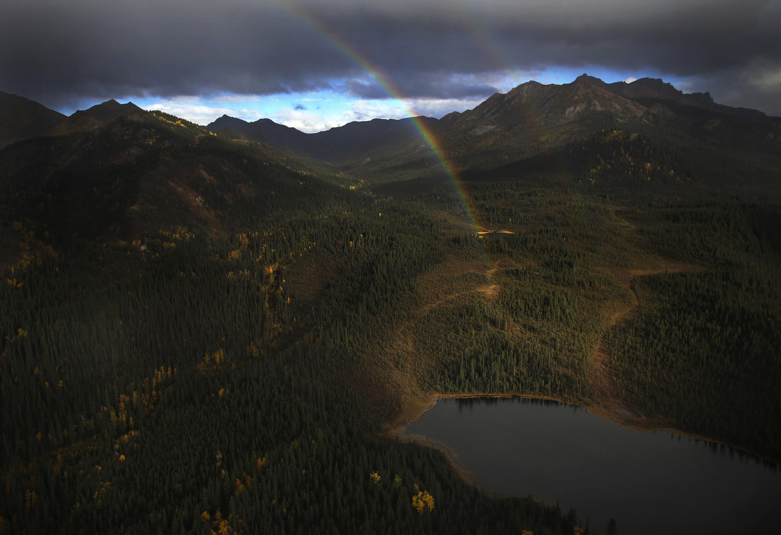 A double rainbow shines in the afternoon light in Denali, Alaska, during a helicopter ride on September 18, 2017.