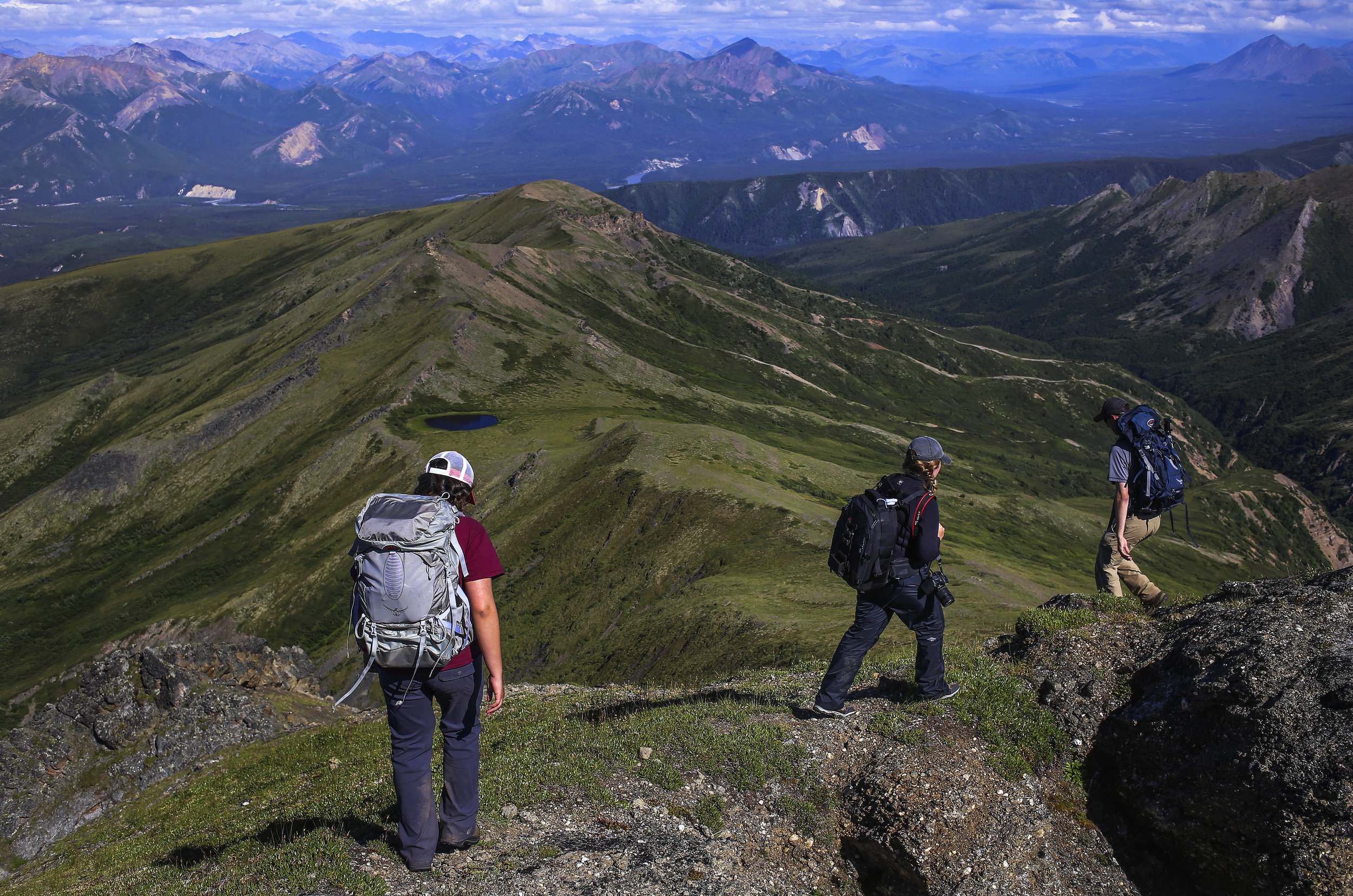 Hikers walk along a ridgeline leading to glacial erratics in Denali National Park and Preserve on July 30, 2017. They started at mile 7.5 of the park road and made their way east, ending at mile 3 where the erratics rest.