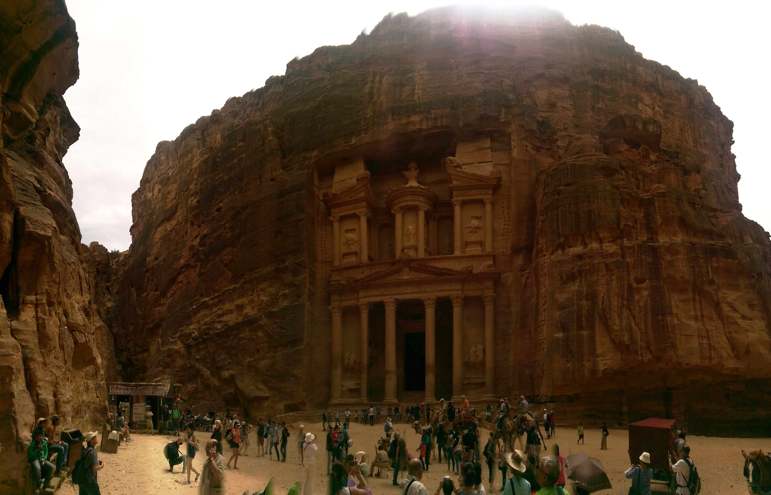 If you can get past the fact that this photo is a flawed attempt at a panoramic, you might notice Al-Khazneh, the Treasury, Petra's most famous façade