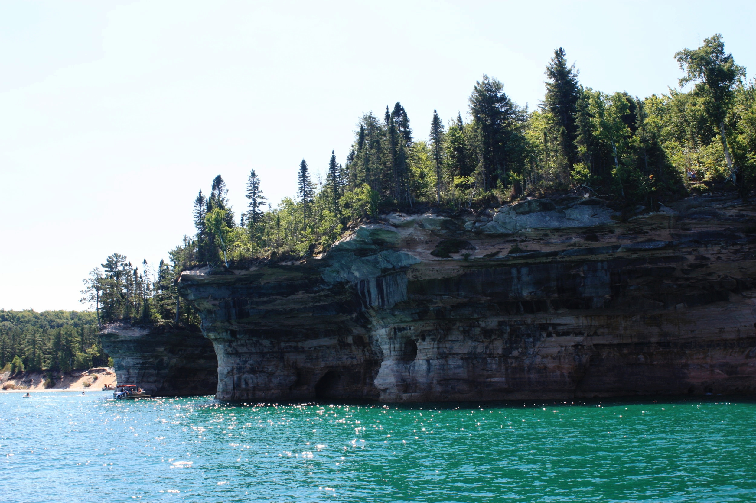 Sticking out like the bows (or sterns?) of ships, these cliffs near  Chapel Beach  are known as Battleship Row. They may be less famous, perhaps, than Miners Castle and some of the other rock formations along the lakeshore, but at least they can hold their heads up high knowing they would completely destroy that puny pontoon in naval warfare.