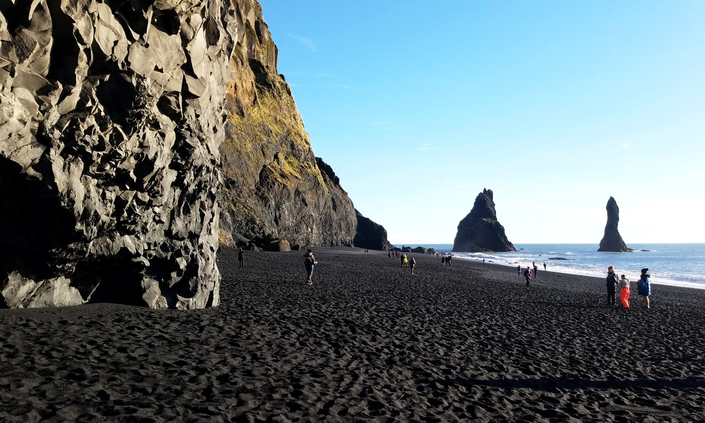 The black sand at Reynisfjara Beach   originated from the basalt lava that covers much of the area