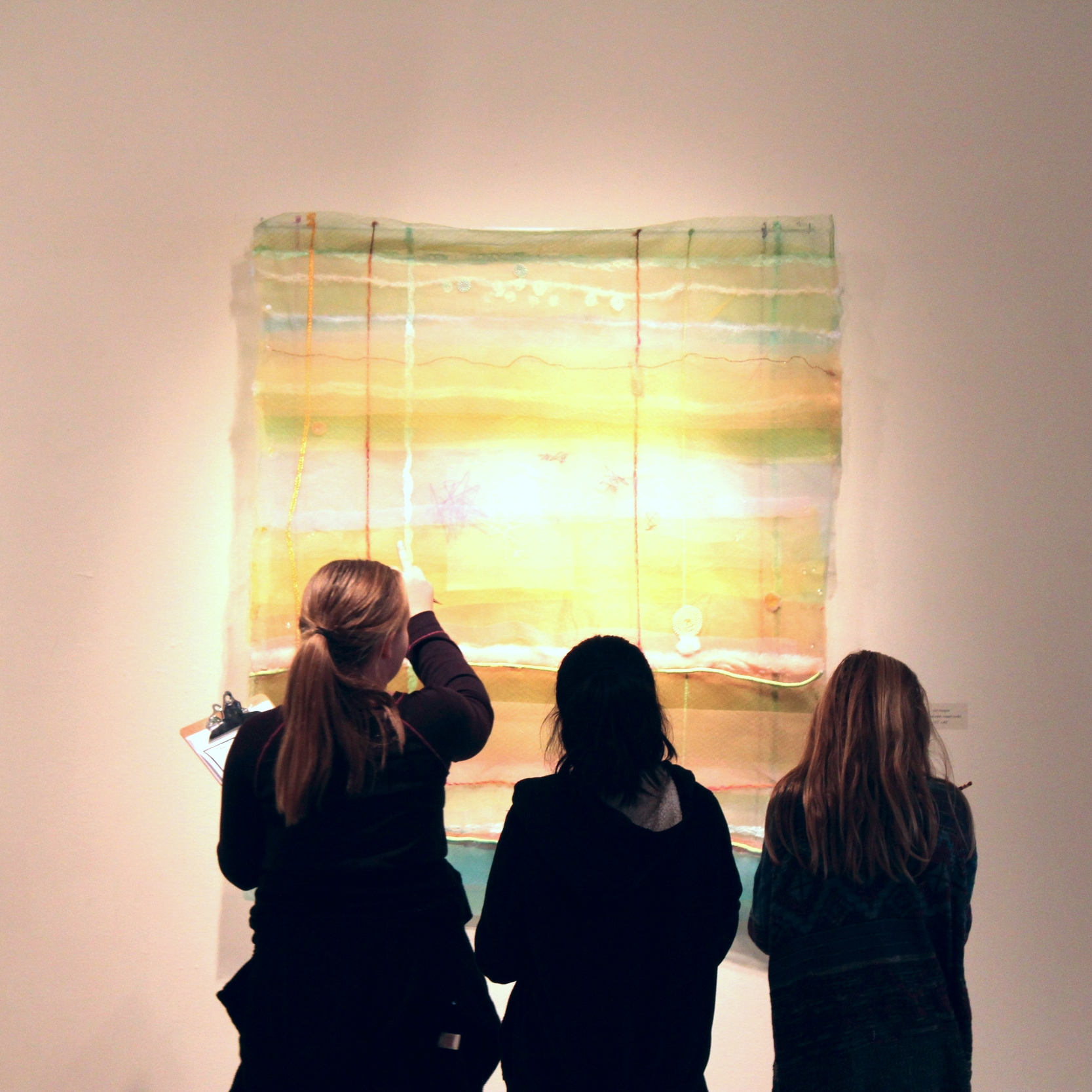 Denton ISD students discuss the work of artist Cathy Breslaw,developing their own interpretations using creative writing and sketching in the galleries.