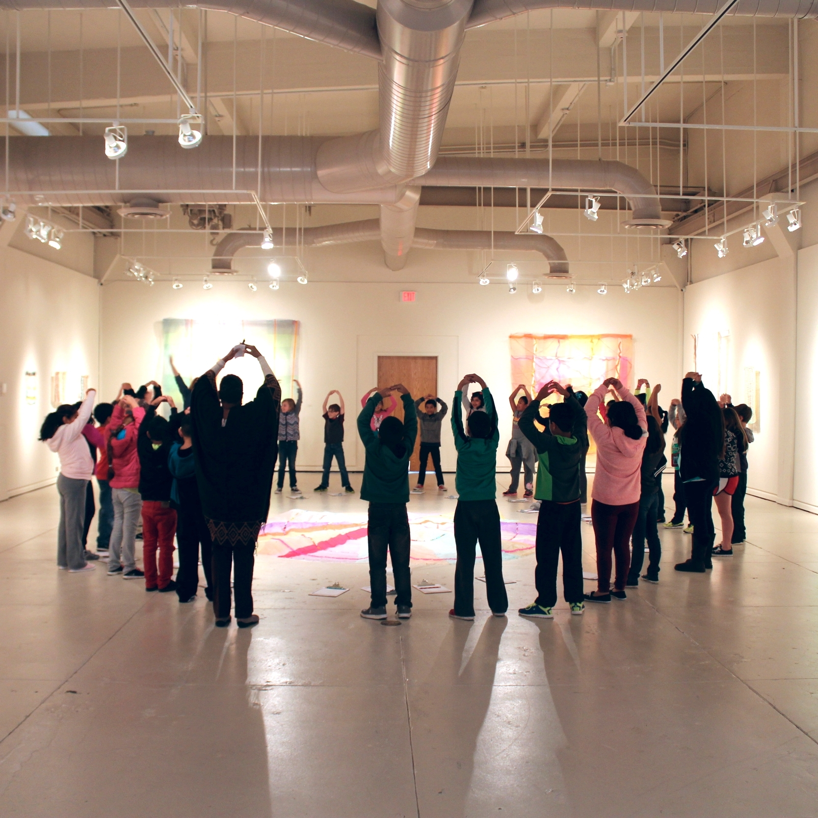 Denton ISD students create original dances in the galleries inspired by the works of artist Cathy Breslaw.