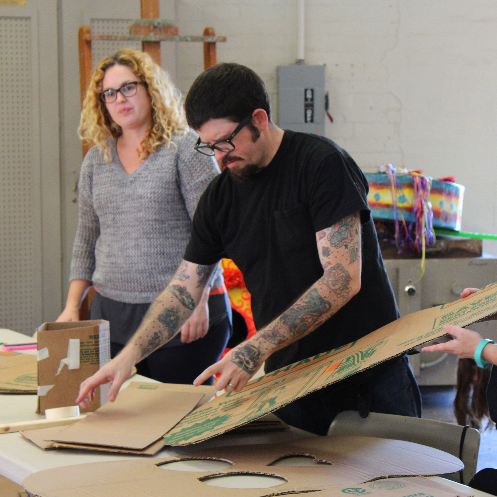 Artist Robert Hamilton instructs students in a Day of the Dead puppet making workshop