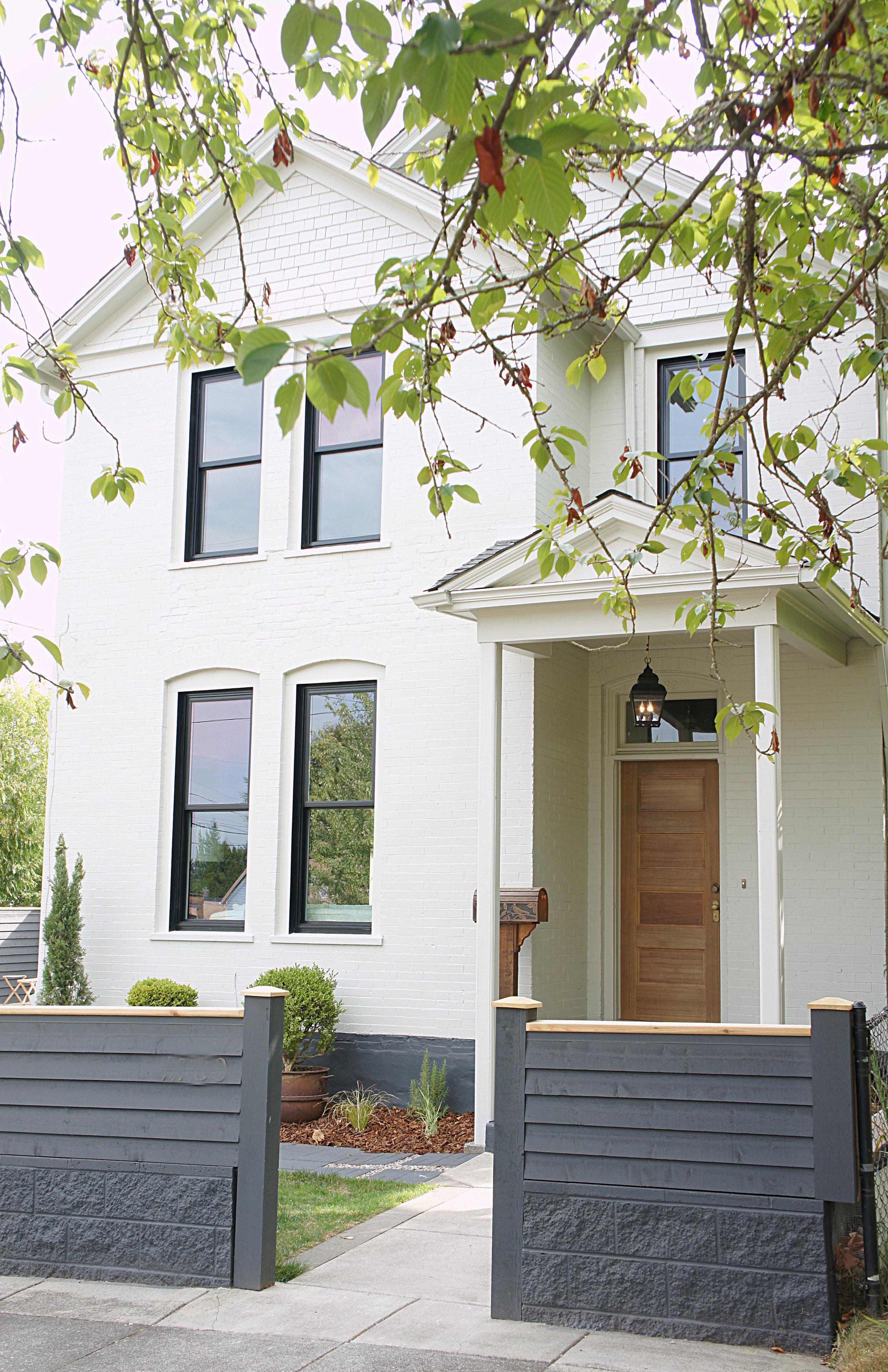 White Victorian Farmhouse by Kaemingk Design