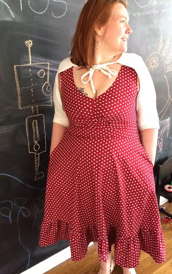Dress by eShakti.  The picture in the background is a robot shooting lasers from its eyes at a dinosaur.