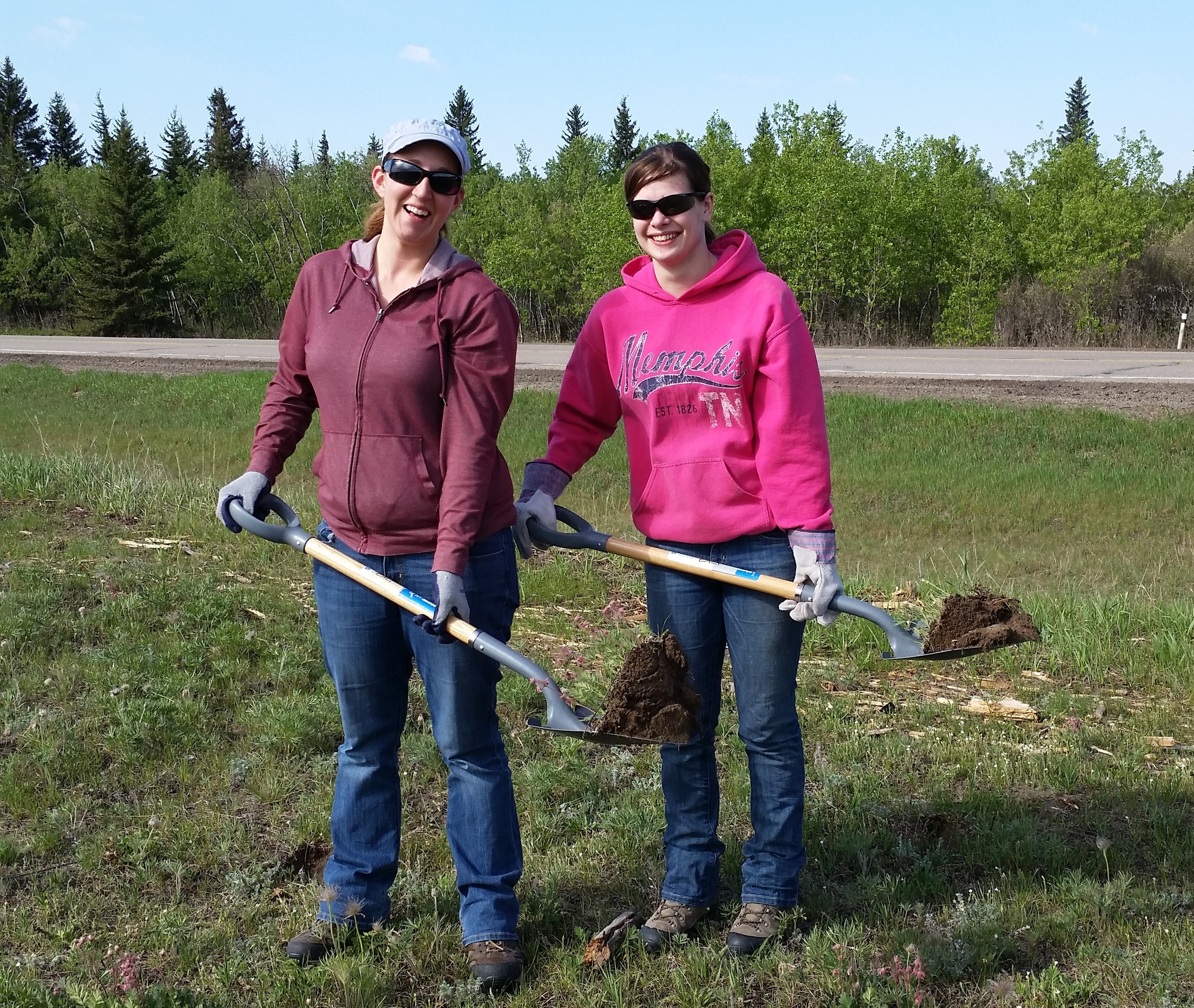 Rebecca and Felysia with their shovels filled with native plants!
