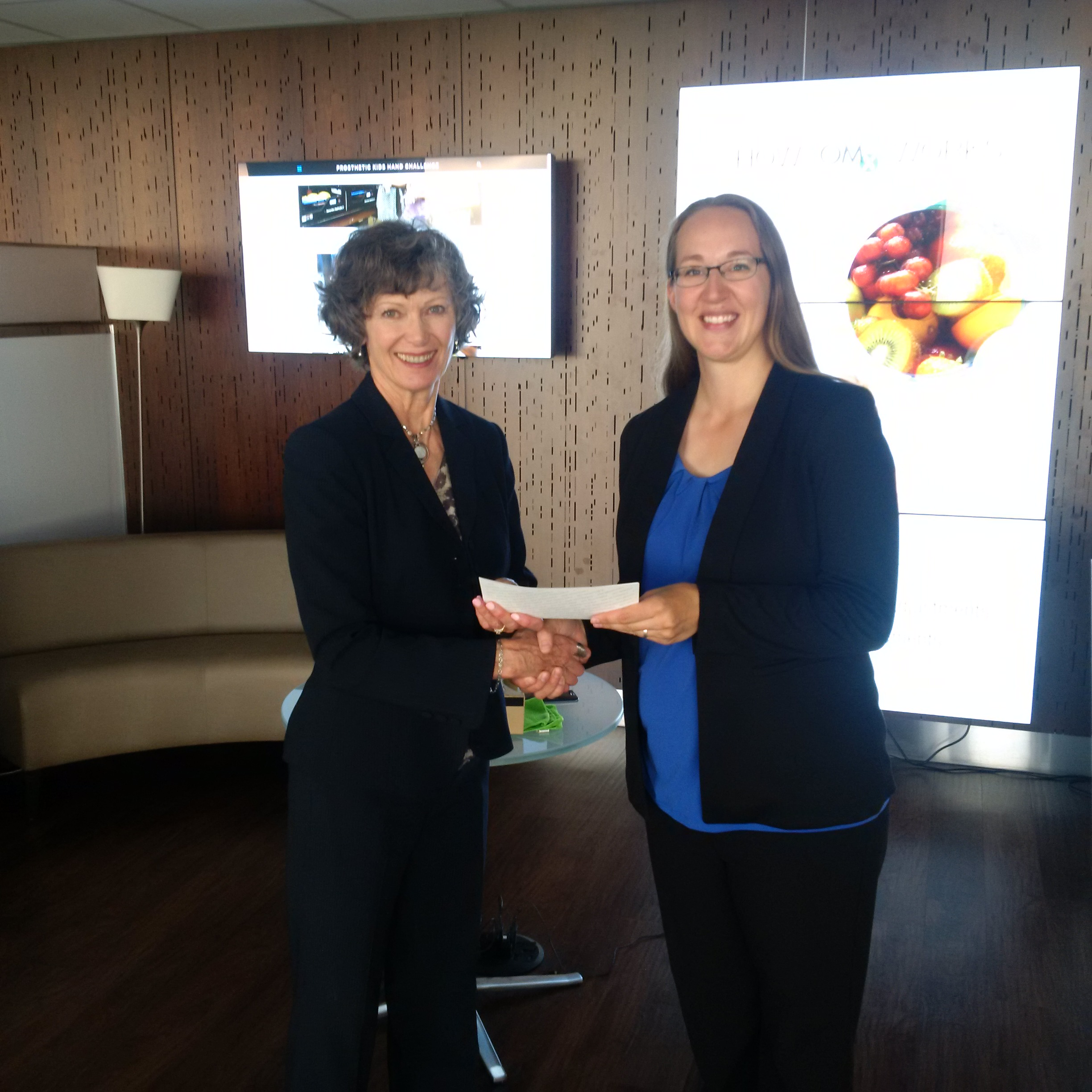 EALT receiving a cheque from Telus Community Board member Ruth Collins-Nakai. Photo by Dan Campbell, Telus.