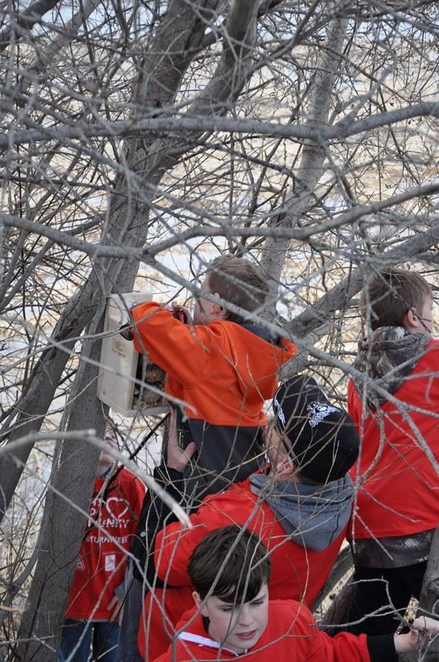 St. Albert Scouts placing Bee Houses along the Sturgeon River