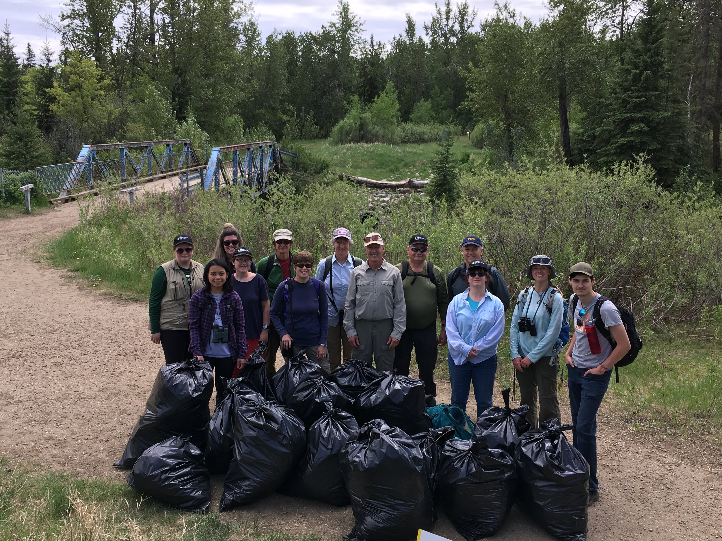 Volunteers remove 15 bags of invasive Leafy Spurge from Larch Sanctuary