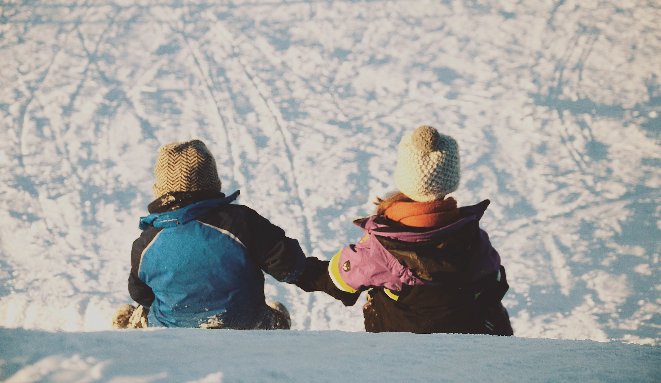 michal-janek-kids in snow-unsplash.jpg