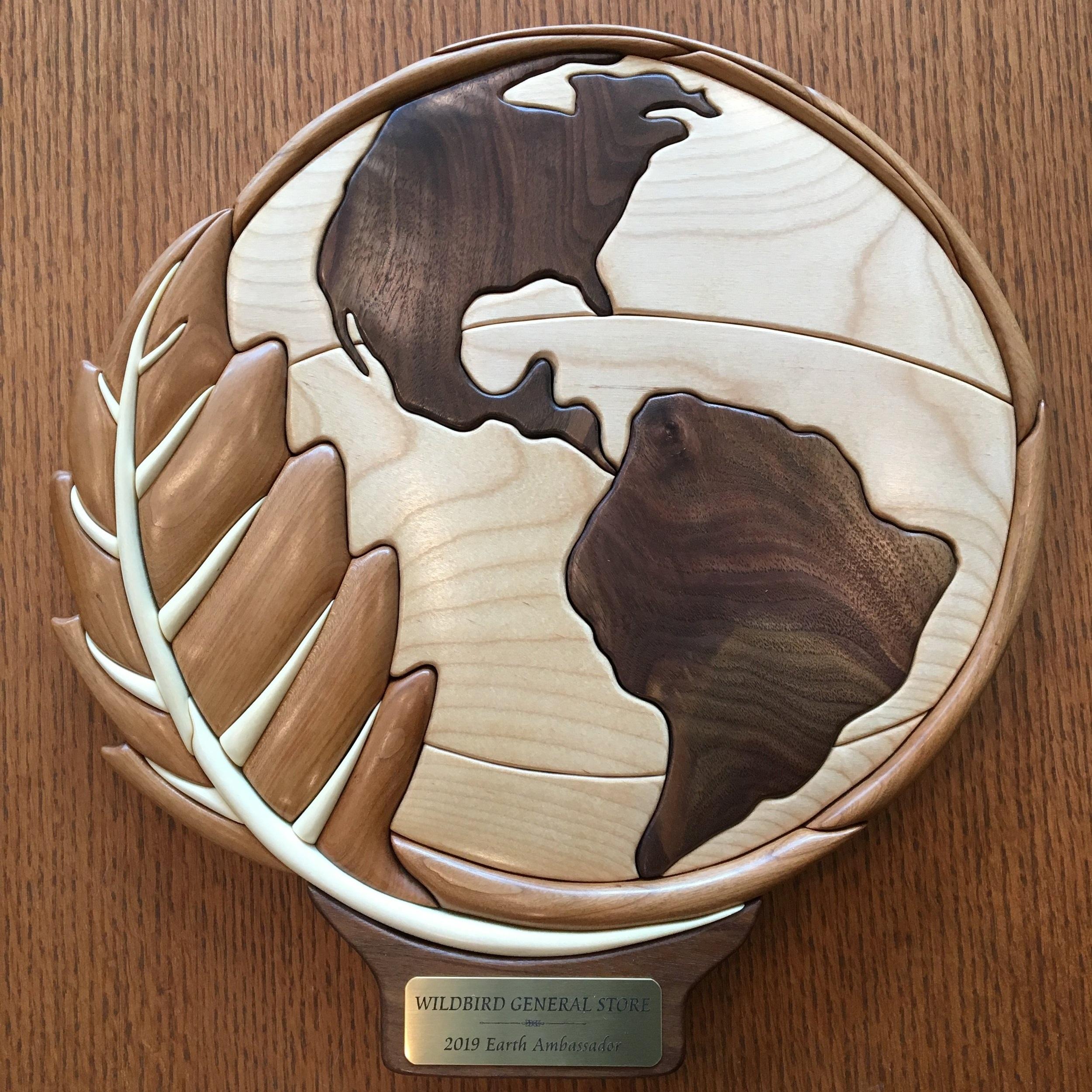 This beautiful handcrafted wood intarsia award was made by EALT volunteer Jamie McQuarrie.