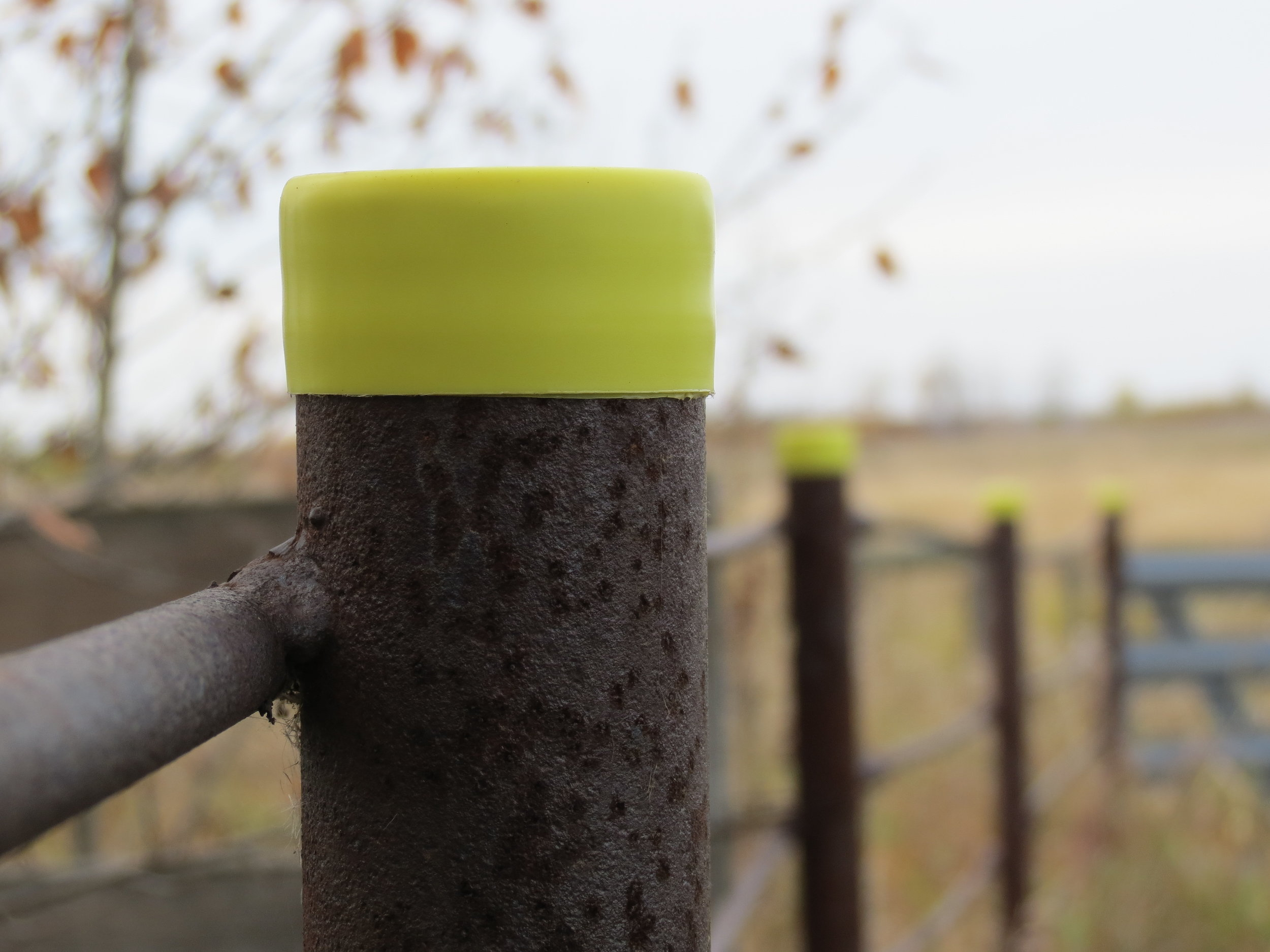Plastic caps are a simple solution to cover open posts.