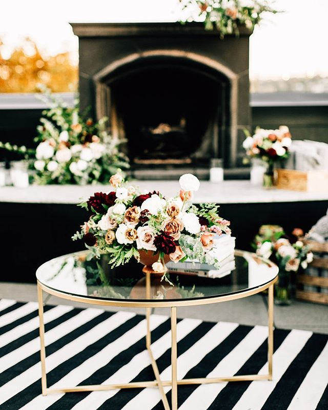 We love creating a space for guests to gather, kick their feet up and relax. Wrap up in a soft blanket next to the fire, beverage in hand and take in the MOMENT. . . . . photography @jennabechtholt florals @briarloft soft seating @fancifulrentals rug @hayneedle planning + design @marriedwithmichelle venue @hotelballard @olympicrooftoppavilion @stoneburnerseattle