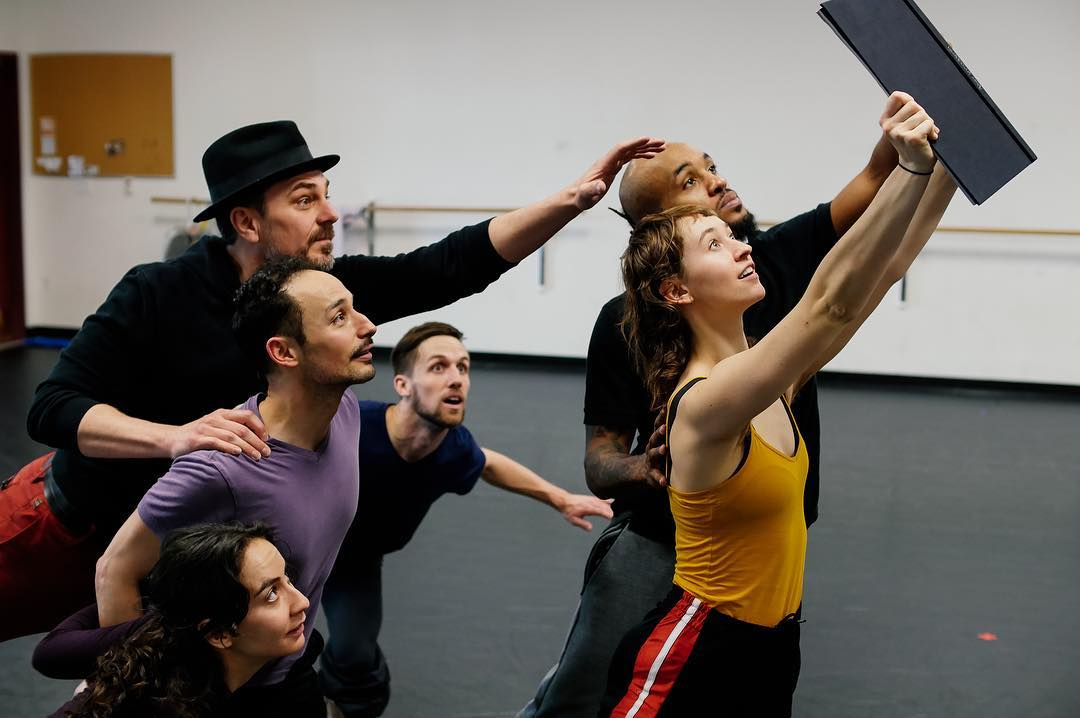 Dancers of Ririe-Woodbury Dance Company and actor Robert Scott Smith (in hat) rehearsing  the live creature and ethereal things.  Photo courtesy of RIrie-Woodbury Dance Company.