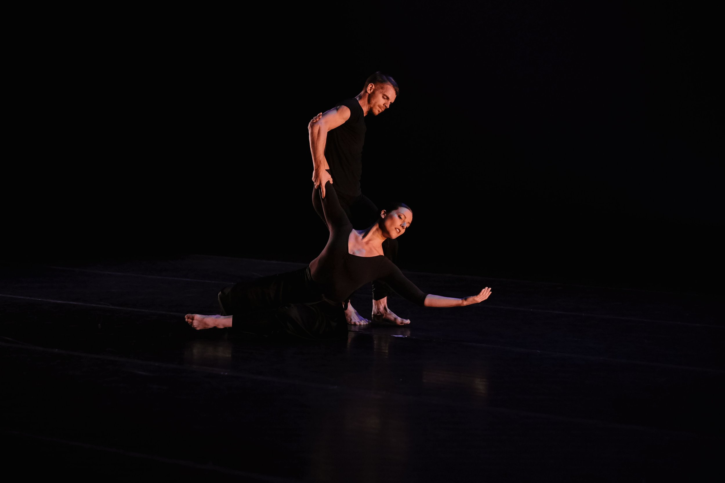 "Lauren Curley and Tyler Orcutt of Repertory Dance Theatre in Doris Humphrey's ""Invention."" Photo by Tori Duhaime."