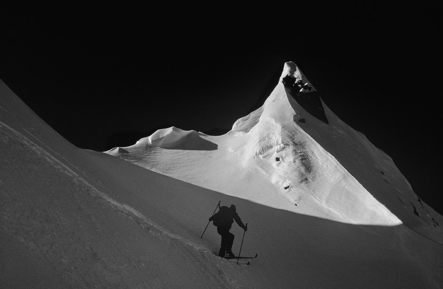 """Monochrome  B&W Cardiac Ascent"". Backcountry Skier Ascends the"