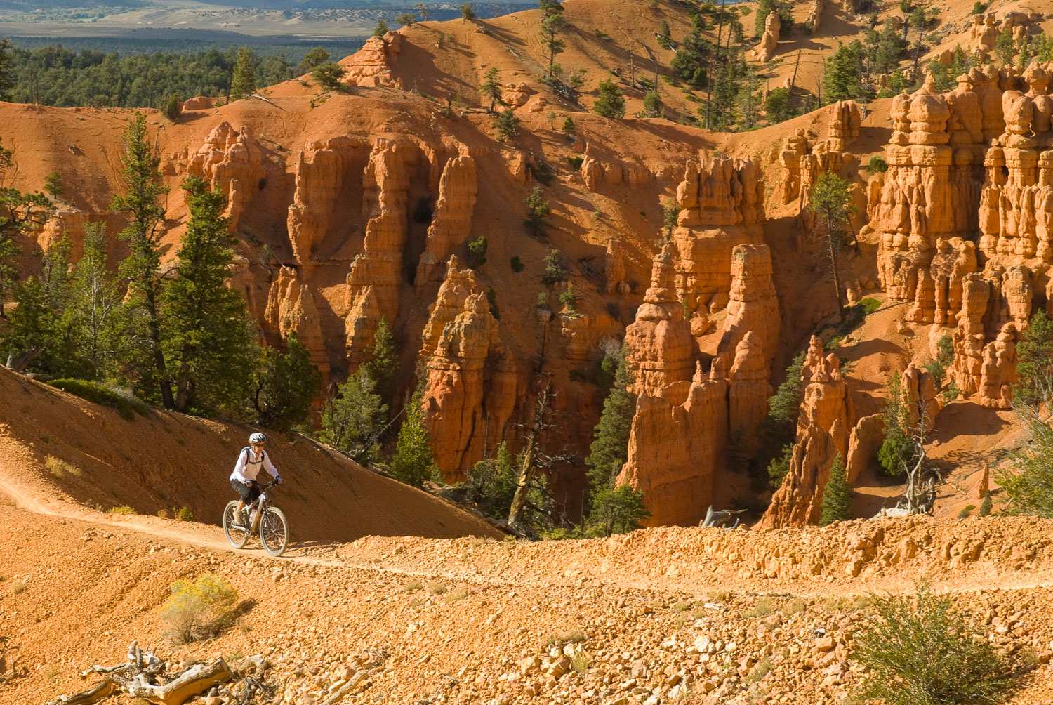 Woman Mountain Biking through the Hoodoos, Thunder Mountain Trai