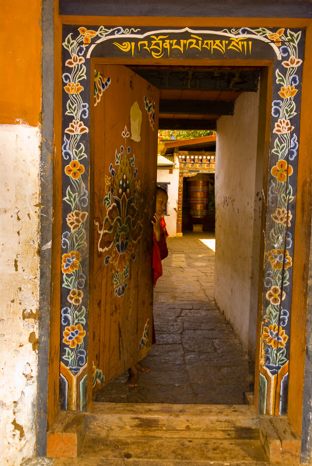 Inner Sanctum , Young Monk opens an ornate Doorway to Temple of