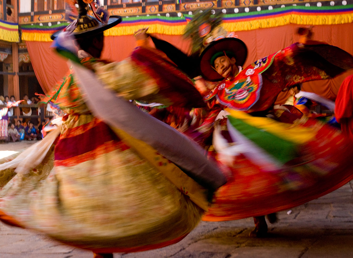 Colorful Dancers in Motion at Jakar Festival, Bhutan