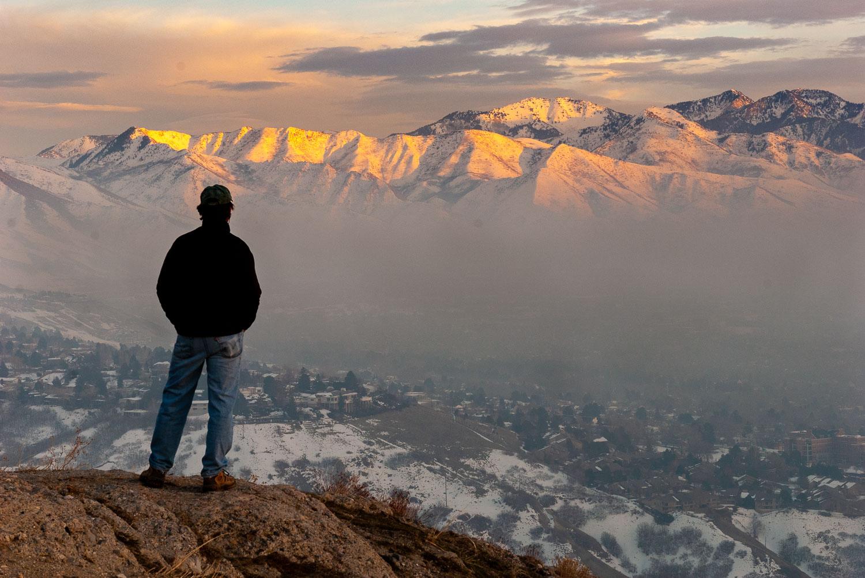 Man Observing air pollution over Salt Lake Valley, Utah