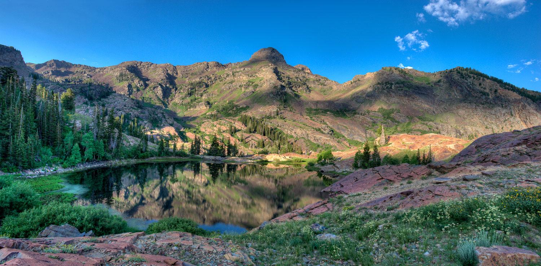 """""""Dromedary Quartzite"""": Dromedary Peak is reflected in Lake Lilli"""