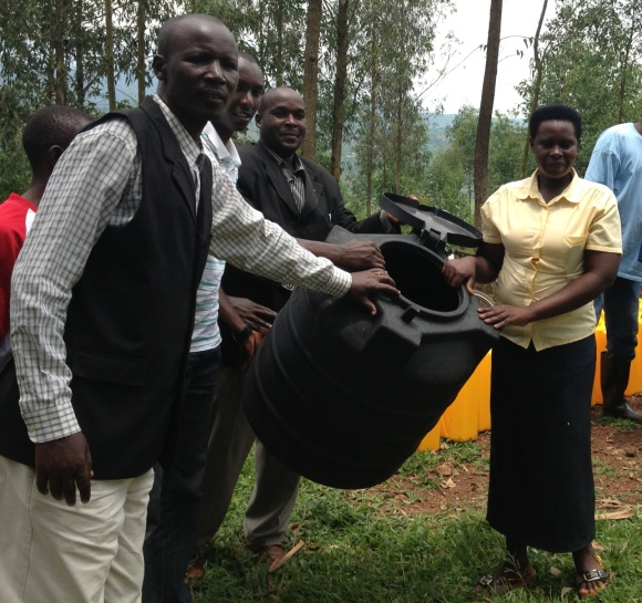 Rwanda - pastor giving away jerry can