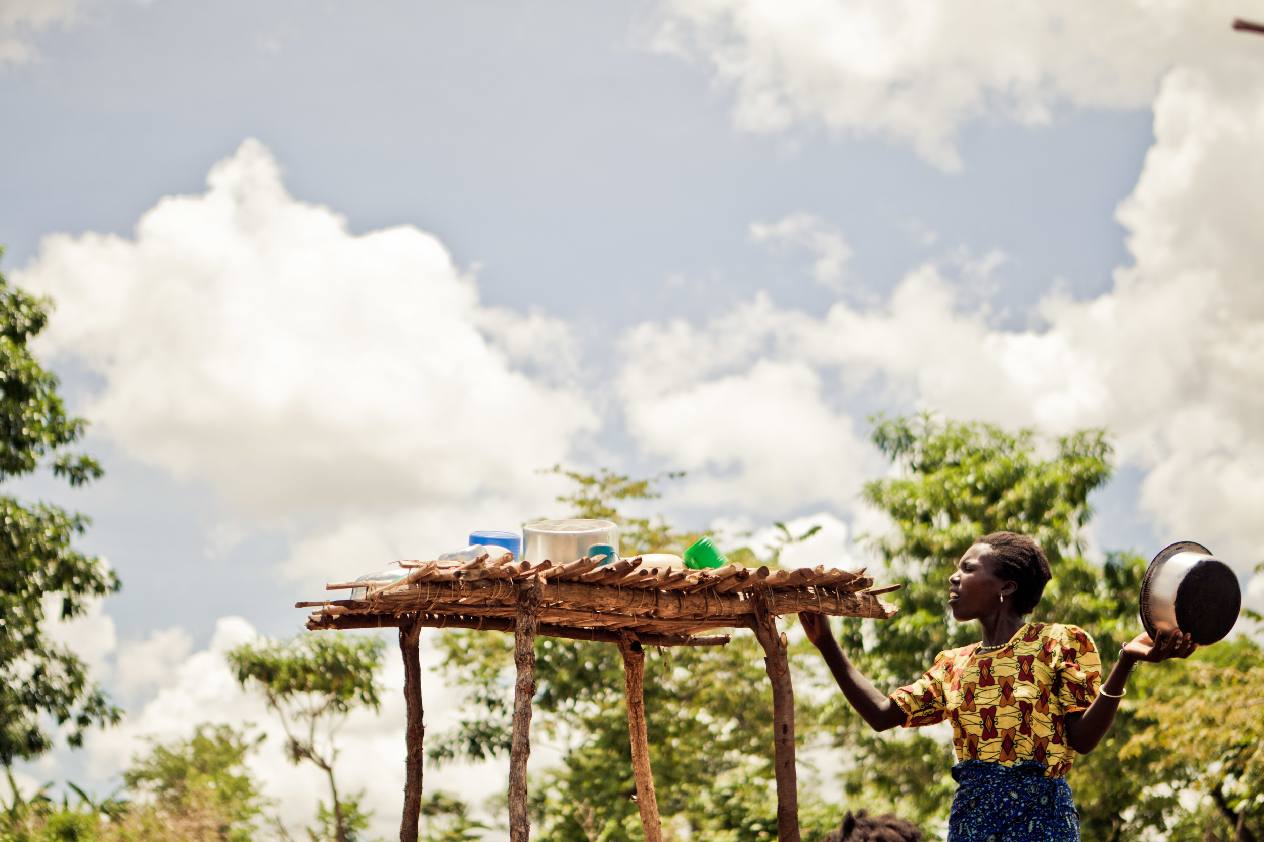 December 17 blog pic_woman drying dishes in Malawi