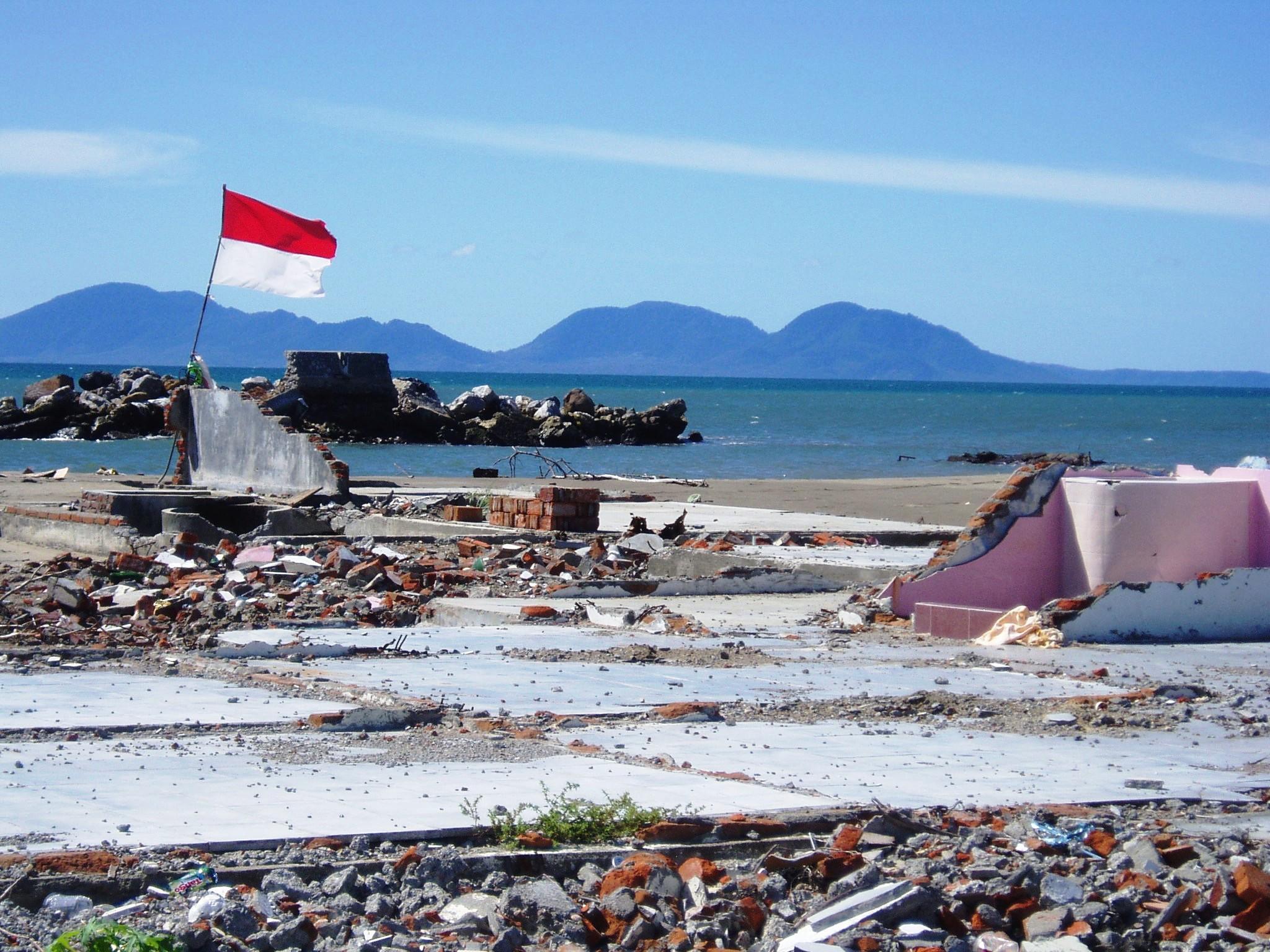December-26-blog-banner_pic-of-devastation-with-Indonesian-flag.jpg