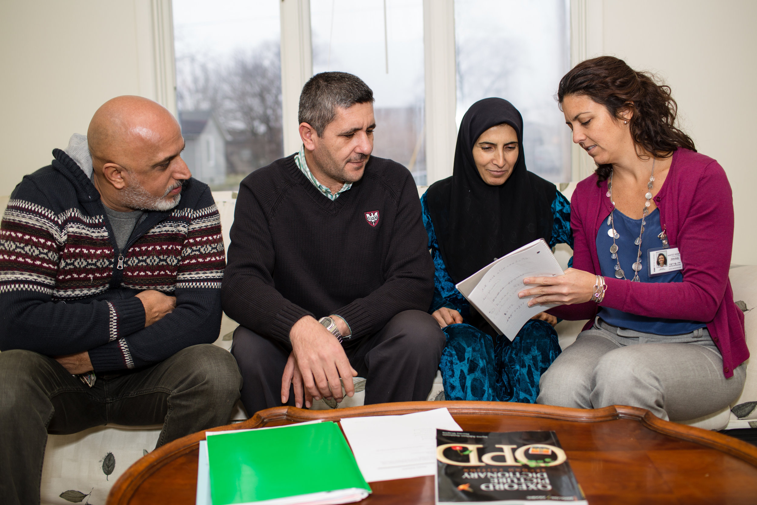 Sasha, World Relief Employment Specialist, assists Ammar & Fatma, Syrian refugee parents of four children, who have been recently resettled by World Relief in Aurora, Illinois. Alaa (pictured, left) works with Sasha to help translate the conversation.