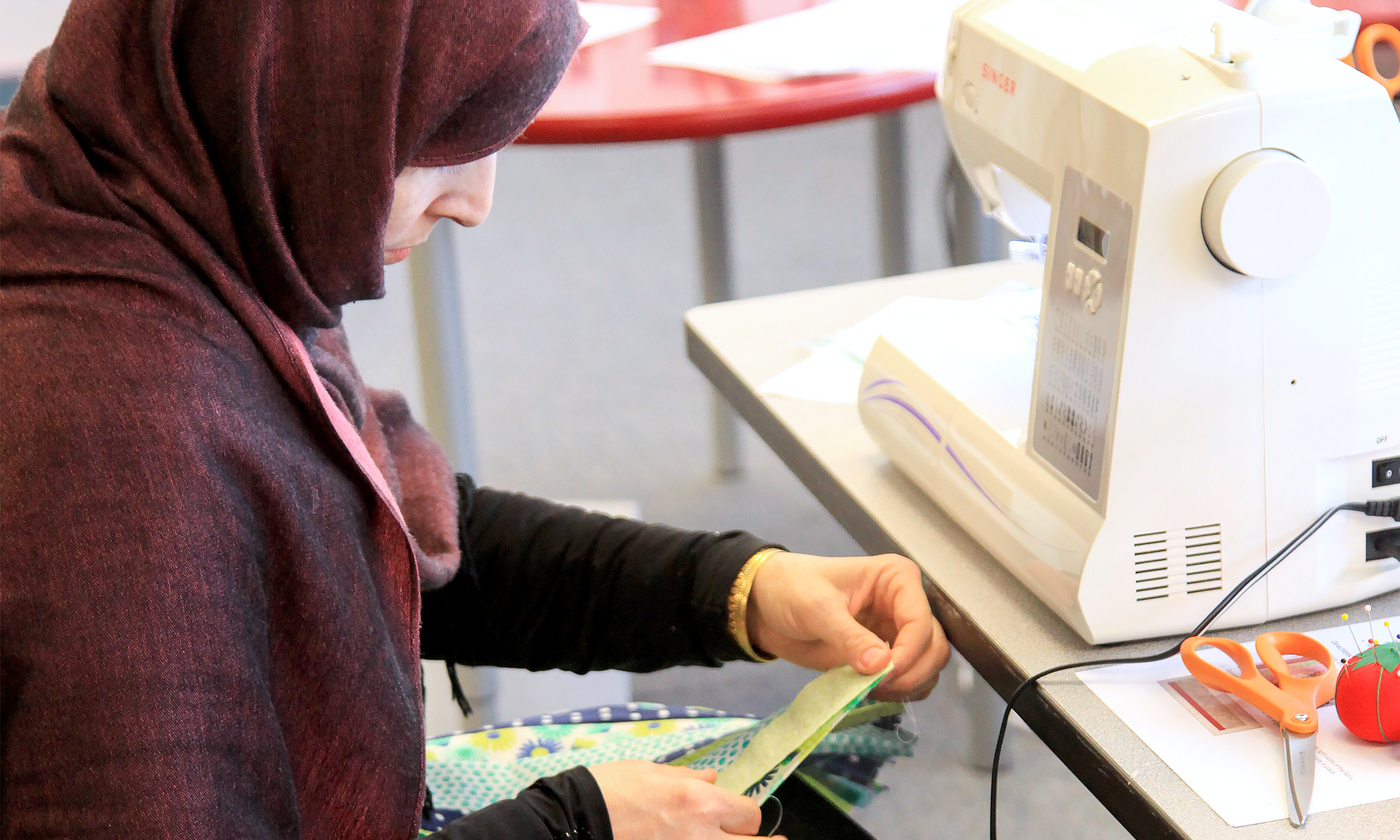 This is Fatima, a 30-year-old Afghan woman and a mother of four. On the first day of World Relief Seattle's inaugural Women's Sewing Class, Fatima clutched her pencil and laboriously copied her name on a pre-test. She had gotten her children ready for school, walked nearly a mile to the bus stop and arrived at her first official class—EVER.