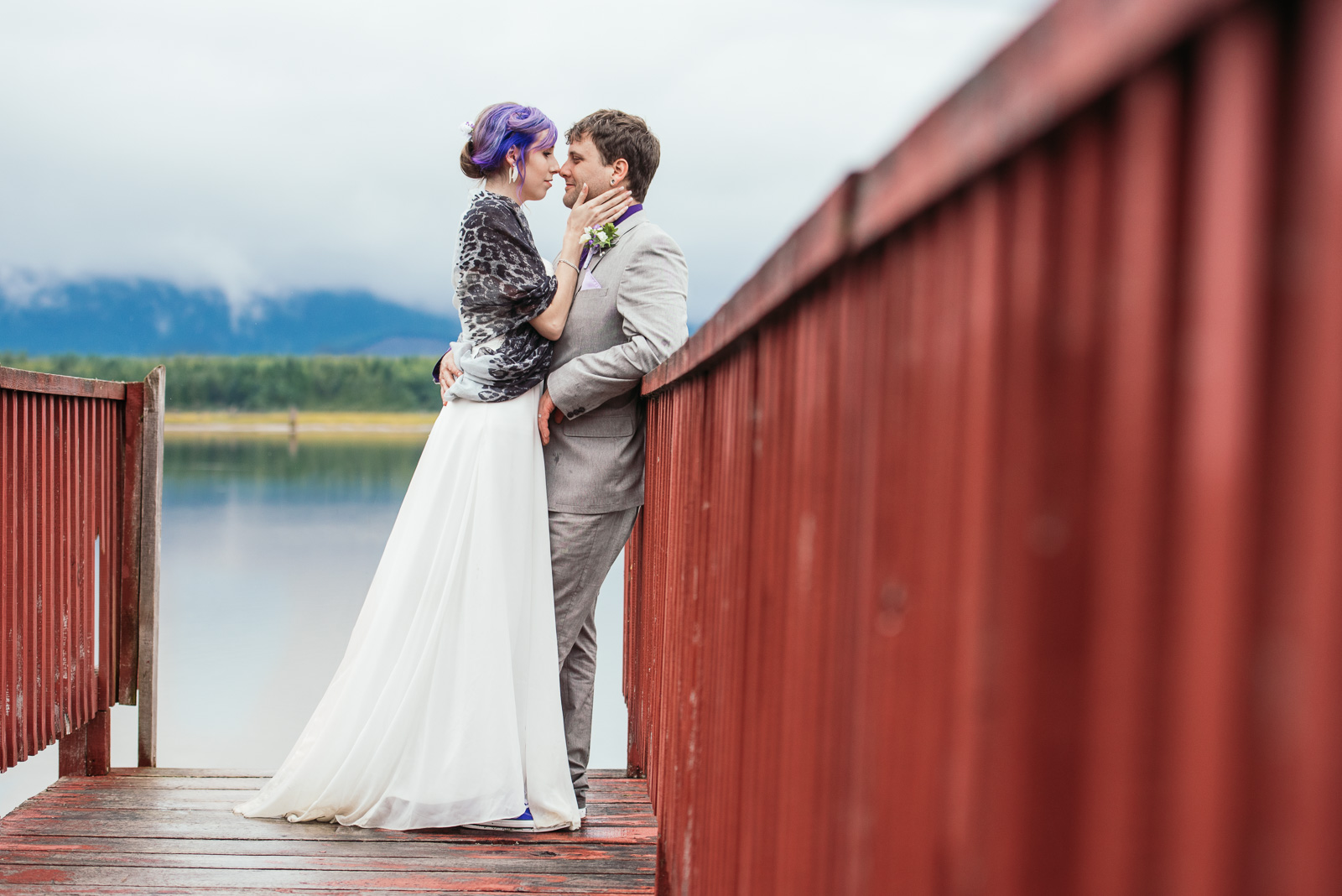 ^ This image from Travis & Kaylee's wedding has just about everything that we love at Pebble & Pine! Mountains, trees, ocean, a rustic red dock, thick cloud cover, and a couple that's crazy about each other. So glad that we found a little time on their wedding day to sneak off to this remote spot. Location scouting pays off!