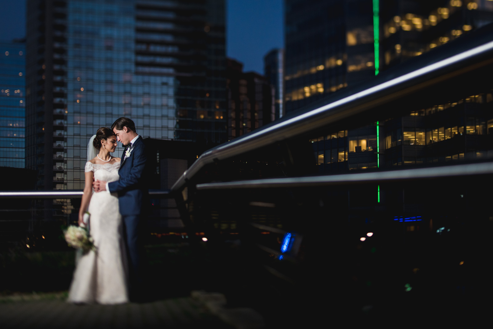 ^ Most of the weddings we shoot tend to be in outdoor natural spaces (which we love), so when we get the opportunity to shoot a wedding in the downtown core of Vancouver, it's a bit of a change of pace for us! For Pegah and Kyle's wedding, we pulled out the lighting equipment for some post-dinner sunset portraits. I love the tones of the city behind them in this one, the leading lines, and their intimate moment.