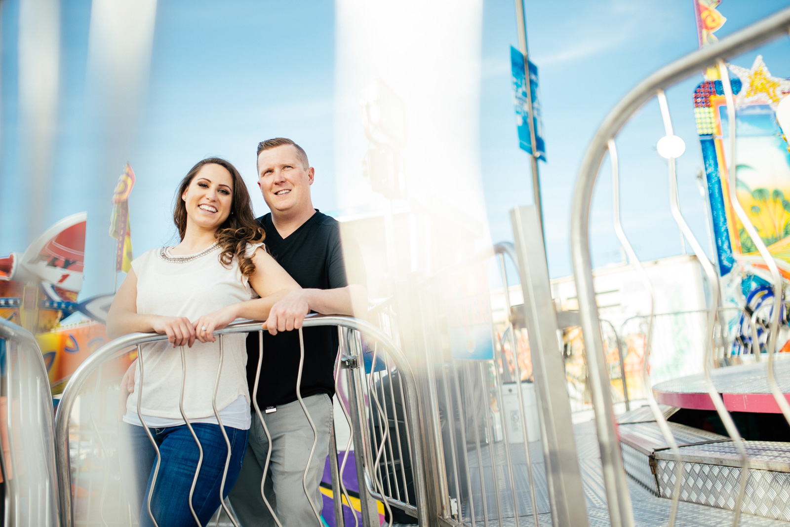 ^ Tanya & John were one of our most fun-loving couples this year, so it was only suiting that we did their engagement photos at an amusement park! The story behind this image is that the amusement park we chose was a very small mobile park in the parking lot of a mall, and PACKED with people! It was challenging to find angles that didn't show the mall or parking lot but still had a lot of colour and fun. This was my favourite from their shoot, and one of my faves of the year overall.