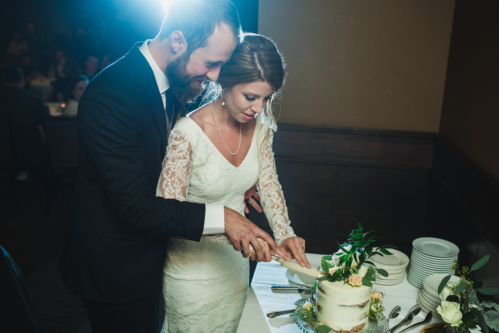 cutting the cake in the ballroom at nita lake lodge in whistler bc - victoria wedding photographers