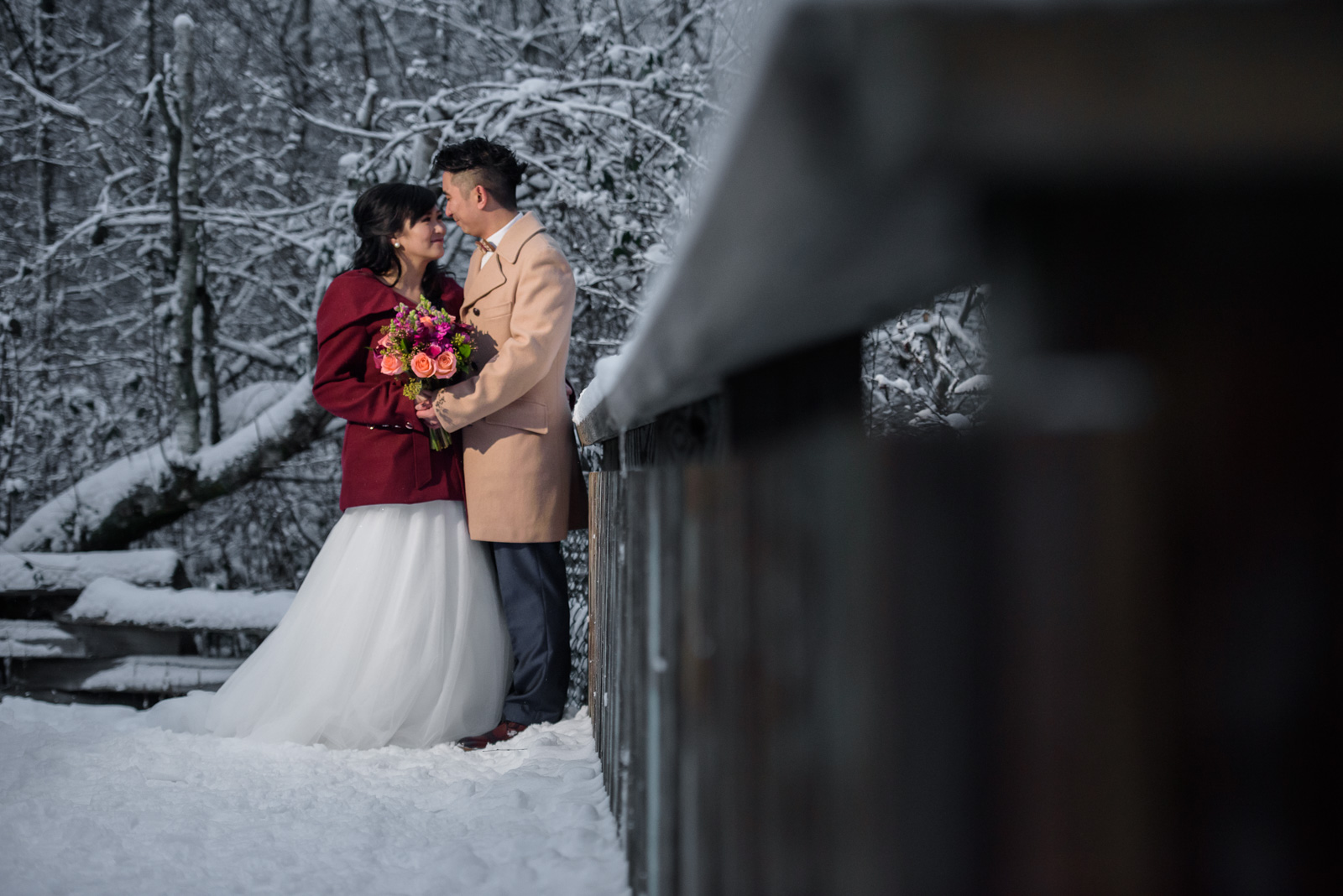 snowy wedding portrait on a bridge in richmond nature park - victoria wedding photographer