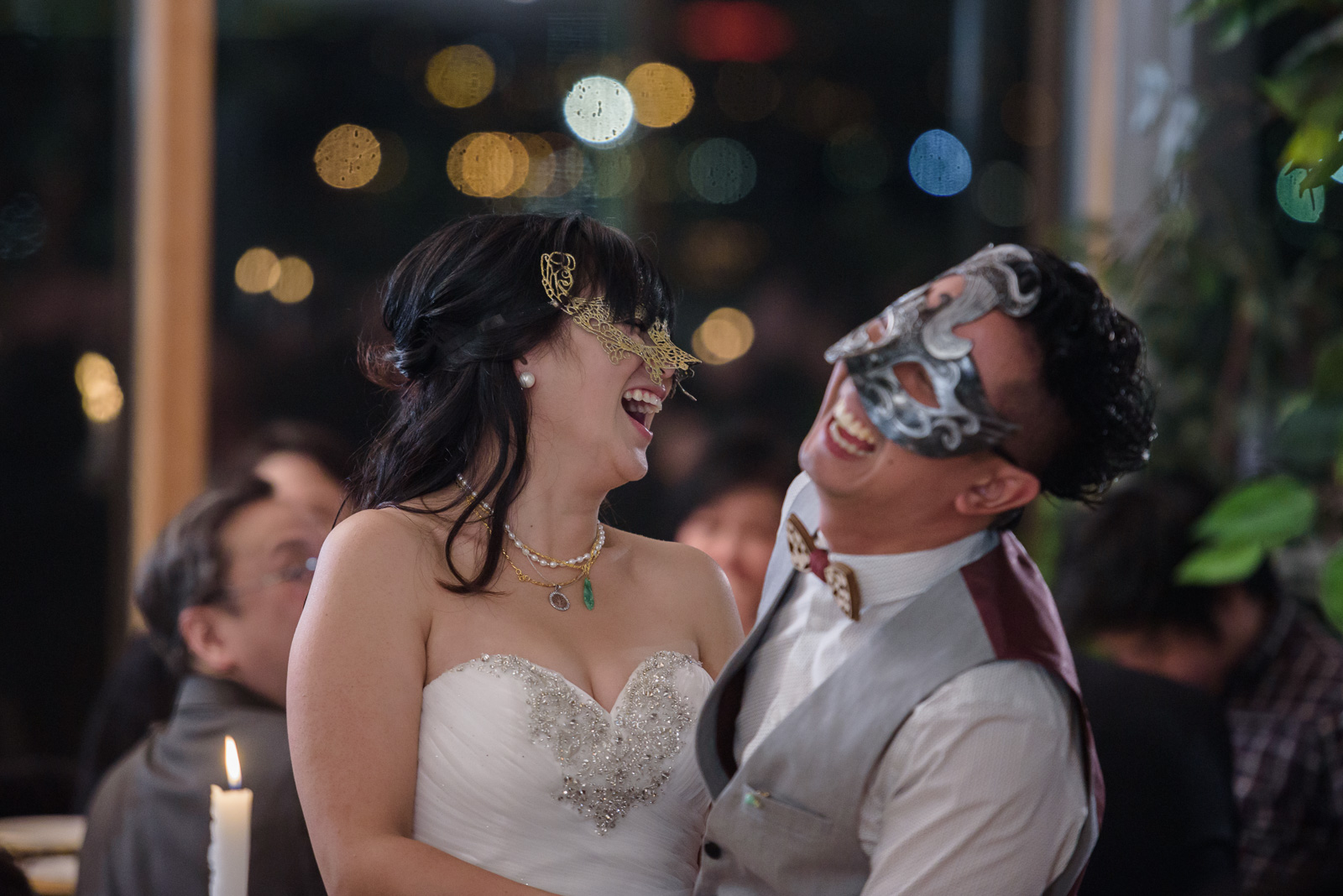 couple laughing at masquerade wedding at ubc boathouse in richmond bc - victoria wedding photographer