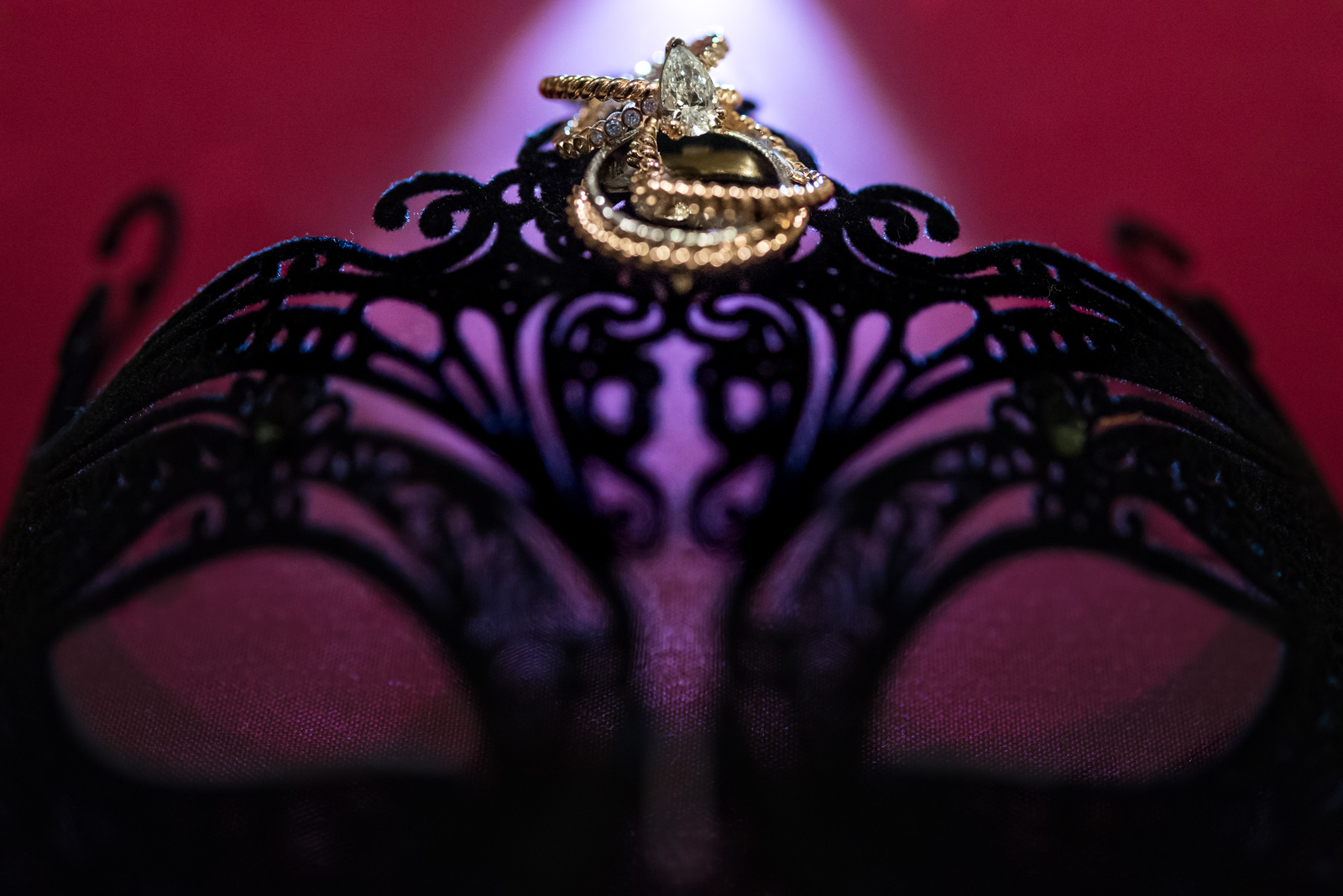 wedding rings on a black lace mask at masquerade wedding at ubc boathouse in richmond bc - victoria wedding photographer