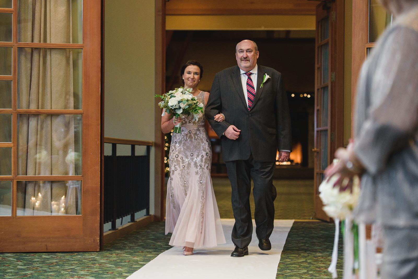 bride entering wedding ceremony at Westwood Plateau - Vancouver Island Wedding Photographers