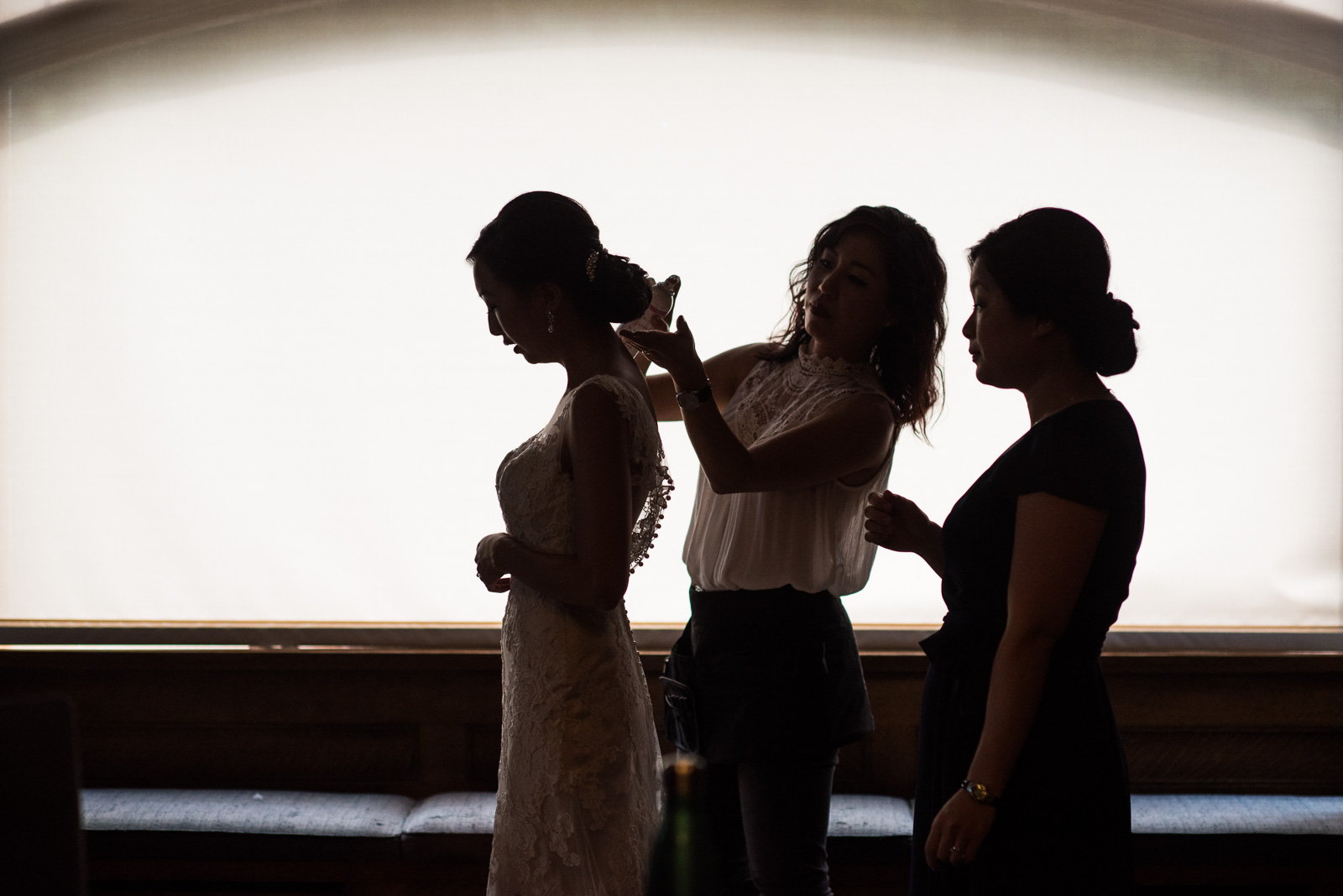 bride getting ready for wedding at cecil green park house on ubc campus in vancouver - victoria wedding photographers